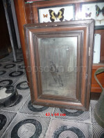 wall mirror in a wooden frame