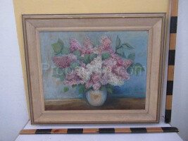 An image of a vase with lilacs
