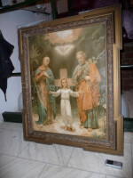 Picture of saints in a wooden ornate frame