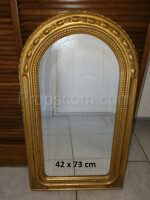wall mirror in a gilded ornate frame