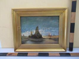image of a sailboat at low tide