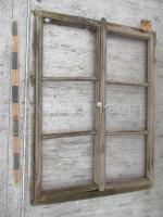 Double-leaf wooden shutters