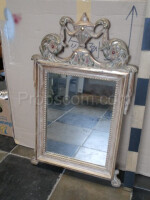 wall mirror with silver ornate frame