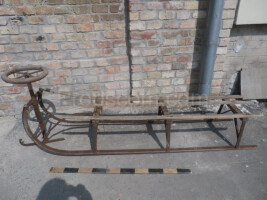 Wooden sled with steering wheel