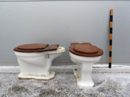 Toilet with wooden lid