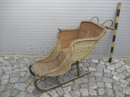 wooden sled with wicker chair