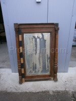 wall mirror in a wooden dark decorated frame