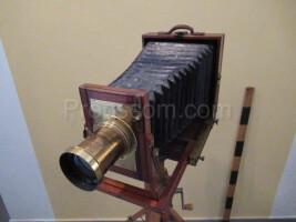 brass camera with tripod