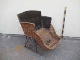 Children's forged sledge with a wicker chair