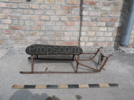 metal sledge with wooden seating