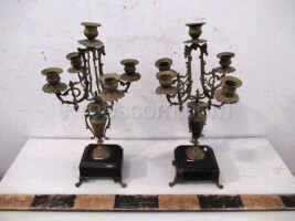 Forged four-armed candlesticks