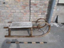 Wooden sled with canvas seat