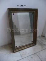 wall mirror in a brass frame